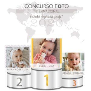 Bebés ganadoras del concurso en el podio